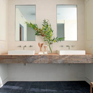 Mid-sized trendy master white tile and porcelain tile porcelain tile and black floor bathroom photo in Chicago with a vessel sink, open cabinets, medium tone wood cabinets, white walls, wood countertops and brown countertops