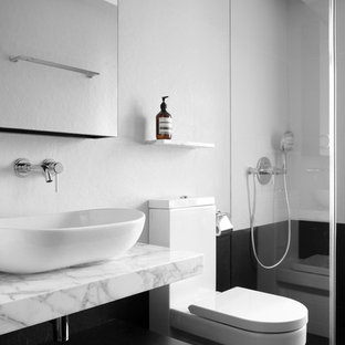 Inspiration for a contemporary bathroom remodel in Hong Kong with a vessel sink and gray walls