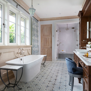 Example of a tuscan multicolored floor bathroom design in Miami with recessed-panel cabinets, dark wood cabinets, gray walls, a vessel sink, a hinged shower door and white countertops