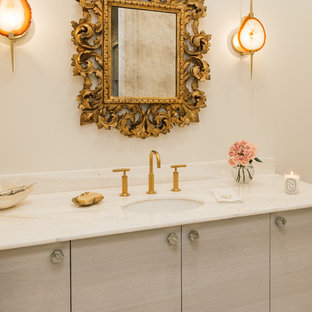 Design ideas for a large contemporary master bathroom in New Orleans with flat-panel cabinets, white walls, an undermount sink, beige cabinets, a freestanding tub, a corner shower, marble, marble floors, marble benchtops, white floor, a hinged shower door and white benchtops.