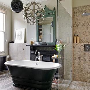 Mediterranean ensuite bathroom in London with a freestanding bath, a corner shower, beige tiles, brown tiles, beige walls, medium hardwood flooring and an open shower.