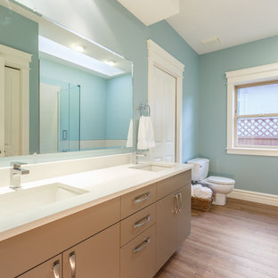 Large trendy master bathroom photo in Vancouver with flat-panel cabinets, gray cabinets and blue walls