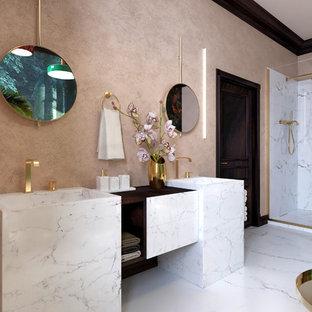 Idée de décoration pour une salle de bain tradition de taille moyenne avec un placard à porte plane, des portes de placard blanches, une douche d'angle, un sol en marbre, un sol blanc, un plan de toilette marron, un carrelage blanc, du carrelage en marbre, un mur rose, un lavabo de ferme, un plan de toilette en bois et une cabine de douche à porte battante.