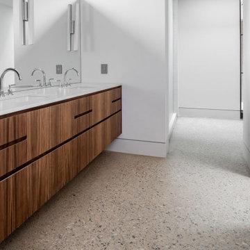 Exposed Aggregate Concrete Floor Accents Mahogany Master Bath