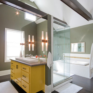 Example of a trendy drop-in bathtub design in Charleston with a vessel sink, furniture-like cabinets and yellow cabinets