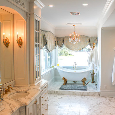 Large cottage chic master gray tile, multicolored tile, white tile and mosaic tile marble floor bathroom photo in New York with a drop-in sink, marble countertops, raised-panel cabinets, white cabinets, a two-piece toilet and white walls