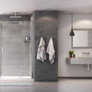 Idee per una stanza da bagno industriale con doccia ad angolo, piastrelle grigie, lastra di pietra e pareti grigie