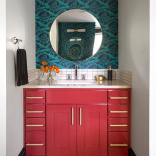 Design ideas for a mid-sized transitional master bathroom in Denver with red cabinets, porcelain floors, an undermount sink, solid surface benchtops, beige benchtops, furniture-like cabinets, white tile, multi-coloured walls and beige floor.