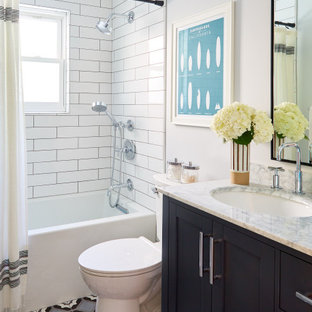 Bathroom - mid-sized coastal 3/4 white tile and subway tile multicolored floor, mosaic tile floor and single-sink bathroom idea in San Francisco with shaker cabinets, black cabinets, white walls, an undermount sink, gray countertops, a one-piece toilet and marble countertops