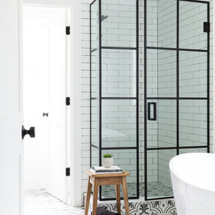 Example of a mid-sized country master white tile and ceramic tile porcelain floor and white floor bathroom design in New York with white walls and a hinged shower door