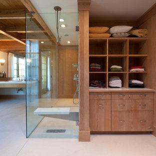 Walk-in shower - large country master concrete floor and beige floor walk-in shower idea in New York with open cabinets, medium tone wood cabinets, brown walls and a drop-in sink