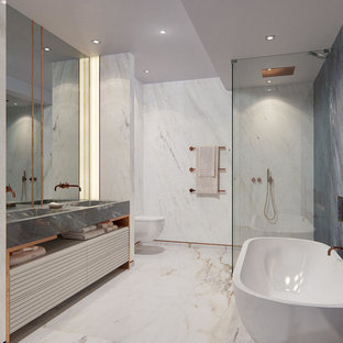 Mid-sized trendy master marble tile multicolored floor bathroom photo in London with open cabinets, a wall-mount toilet, multicolored walls, an integrated sink and a hinged shower door
