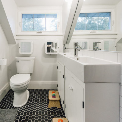 Example of a small trendy kids' black and white tile and porcelain tile porcelain tile alcove shower design in Minneapolis with furniture-like cabinets, white cabinets, a two-piece toilet, gray walls and a wall-mount sink