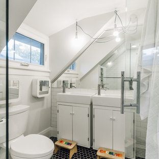 Alcove shower - small contemporary kids' black and white tile and porcelain tile porcelain floor alcove shower idea in Minneapolis with furniture-like cabinets, white cabinets, a two-piece toilet, gray walls and a wall-mount sink