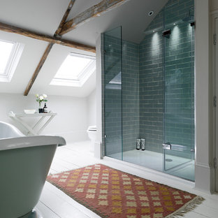 This is an example of a rural bathroom in Other with a freestanding bath, an alcove shower, metro tiles, white walls, painted wood flooring, blue tiles and a hinged door.