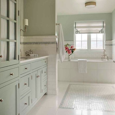 Example of a huge classic master white tile and mosaic tile marble floor bathroom design in Los Angeles with shaker cabinets, blue cabinets, an undermount tub, a wall-mount toilet, blue walls and marble countertops
