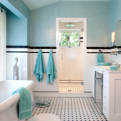 Elegant mosaic tile and black and white tile multicolored floor freestanding bathtub photo in Other with a console sink
