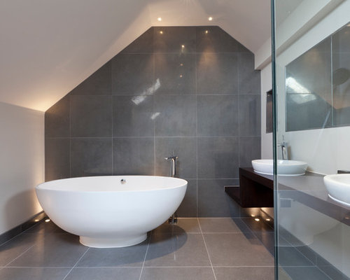 Example Of A Trendy Gray Tile Freestanding Bathtub Design In London With A  Vessel Sink,