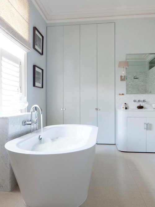 Luxury bathroom lighting houzz trendy freestanding bathtub photo in london with flat panel cabinets white cabinets and gray mozeypictures Choice Image