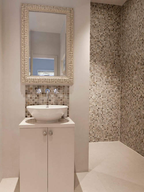 example of a trendy walk in shower design in london with a vessel sink