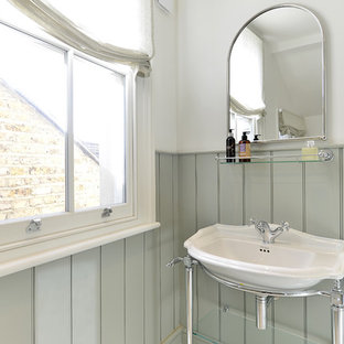 Inspiration for a medium sized victorian family bathroom in London with flat-panel cabinets, green cabinets, an alcove bath, a walk-in shower, a one-piece toilet, green tiles, white walls, medium hardwood flooring, a built-in sink, wooden worktops, white floors and an open shower.