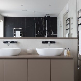 Design ideas for a large contemporary ensuite bathroom in Hertfordshire with beige cabinets, a one-piece toilet, porcelain tiles, porcelain flooring, quartz worktops, beige worktops, flat-panel cabinets, a vessel sink, grey floors and double sinks.