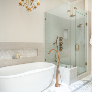 Example of a large classic master gray tile and ceramic tile marble floor and multicolored floor bathroom design in Dallas with recessed-panel cabinets, white cabinets, a two-piece toilet, beige walls, a vessel sink, engineered quartz countertops, a hinged shower door and white countertops