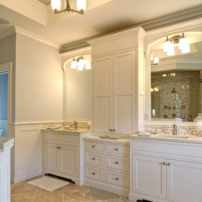 Elegant beige tile and mosaic tile bathroom photo in Other with shaker cabinets and white cabinets