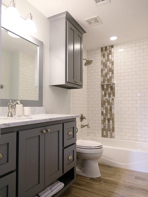 bath a shower bath combination vinyl flooring and a two piece toilet