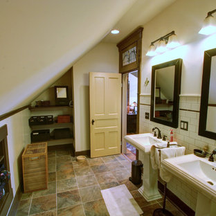 Inspiration for a country subway tile bathroom remodel in Columbus with a pedestal sink