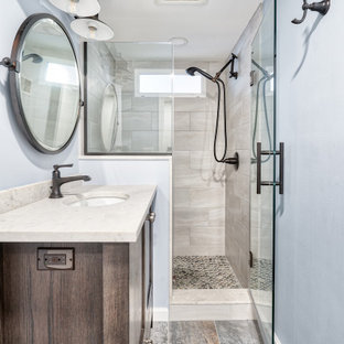 This is an example of a small farmhouse bathroom in New York with recessed-panel cabinets, medium wood cabinets, a two-piece toilet, grey tiles, a submerged sink, copper worktops, grey floors, a hinged door, white worktops, a wall niche, a single sink and a freestanding vanity unit.