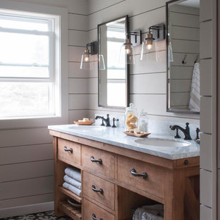 Example of a mid-sized country master gray tile and ceramic tile ceramic tile and black floor bathroom design in Burlington with open cabinets, medium tone wood cabinets, a two-piece toilet, gray walls, an undermount sink and marble countertops