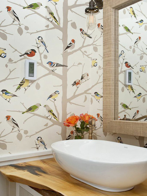 Example Of A Country Bathroom Design In New York With Vessel Sink Wood Countertops