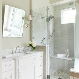 Inspiration for a country gray tile alcove shower remodel in Dallas with white cabinets, beige
