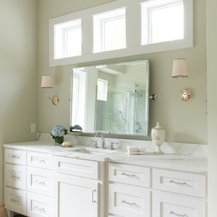 """""""pivot mirror"""". Country bathroom photo in Dallas with shaker cabinets, white cabinets and beige walls"""