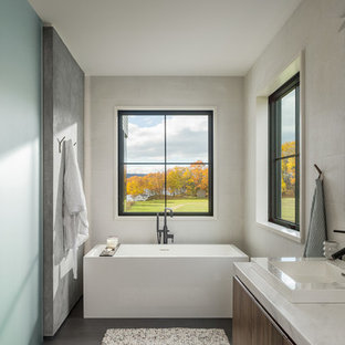 Inspiration For A Farmhouse Brown Floor Freestanding Bathtub Remodel In  Burlington With Flat Panel Cabinets