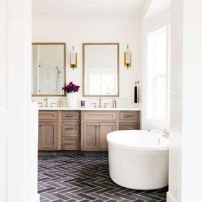 Large farmhouse master porcelain tile and black floor freestanding bathtub photo in San Diego with shaker cabinets, dark wood cabinets, white walls, an undermount sink and quartz countertops