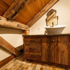 Farmhouse Bathroom by HeritageBarns.com