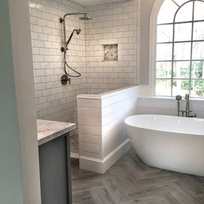 Inspiration for a mid-sized cottage master white tile and ceramic tile ceramic tile and gray floor bathroom remodel in Atlanta with shaker cabinets, gray cabinets, a two-piece toilet, gray walls, an undermount sink, marble countertops and a hinged shower door