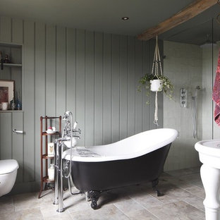 This is an example of a medium sized romantic wet room bathroom in Hertfordshire with a claw-foot bath, a wall mounted toilet, white tiles, grey walls, travertine flooring, a console sink, grey floors and an open shower.