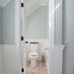 Example of a mid-sized farmhouse master multicolored tile and subway tile porcelain tile bathroom design in Chicago with an undermount sink, raised-panel cabinets, white cabinets, quartzite countertops, a two-piece toilet and green walls
