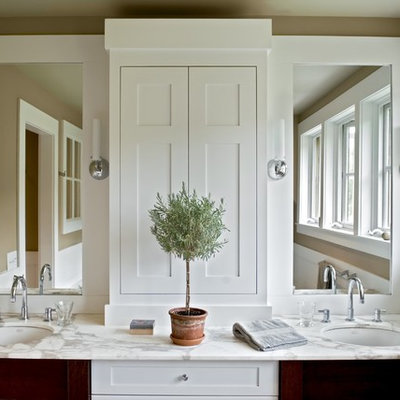 Country bathroom photo in Burlington with marble countertops