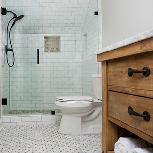 Design ideas for a small country family bathroom in Atlanta with flat-panel cabinets, light wood cabinets, an alcove shower, a two-piece toilet, white tiles, ceramic tiles, grey walls, marble flooring, a submerged sink, quartz worktops, multi-coloured floors and a hinged door.