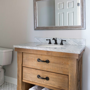 Example of a small cottage kids' white tile and ceramic tile marble floor and multicolored floor alcove shower design in Atlanta with flat-panel cabinets, light wood cabinets, a two-piece toilet, gray walls, an undermount sink, quartzite countertops and a hinged shower door