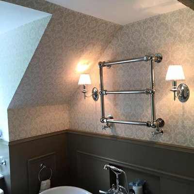 Example of a mid-sized cottage chic freestanding bathtub design in Glasgow with a wall-mount toilet