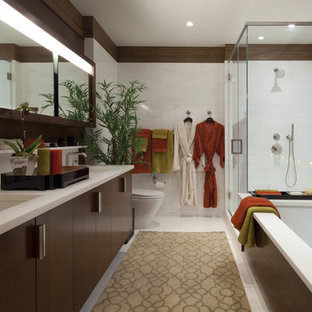 Example of a mid-sized trendy master white tile and porcelain tile porcelain floor corner shower design in New York with an undermount sink, flat-panel cabinets, dark wood cabinets, an undermount tub, brown walls and marble countertops