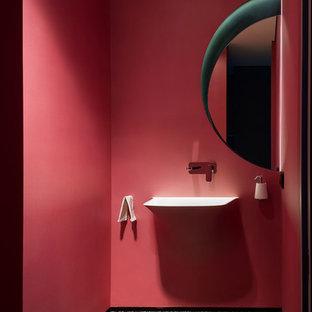 Foto de cuarto de baño infantil, moderno, de tamaño medio, con bidé, baldosas y/o azulejos rojos, baldosas y/o azulejos de mármol, paredes verdes, suelo de baldosas de cerámica, encimera de cemento, suelo blanco y ducha abierta