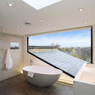 Photo of a contemporary master bathroom in London with an integrated sink, a freestanding tub, an open shower and an open shower.