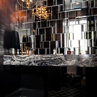 Пример оригинального дизайна интерьера: ванная комната в стиле модернизм с накладной раковиной, черными фасадами, мраморной столешницей, черно-белой плиткой, зеркальной плиткой, черными стенами и душевой кабиной
