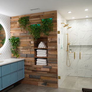 Example of a large danish master white tile and porcelain tile porcelain floor and gray floor bathroom design in Atlanta with flat-panel cabinets, blue cabinets, a one-piece toilet, blue walls, an undermount sink, quartz countertops, a hinged shower door and white countertops